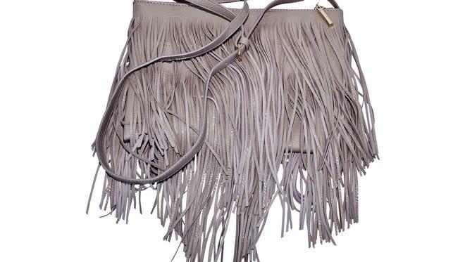 Gray fringe cross body purse, $56.