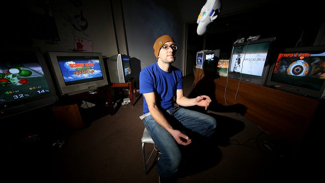 Jory Ray, owner of All That and a Bag of Chips, opened his gaming den at 702 S. College Ave.