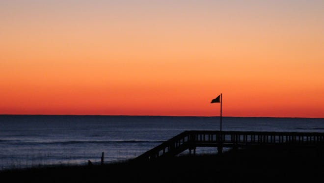 One advantage to the Florida Panhandle is that you can see both the sunset (pictured) and sunrise from its south-facing beaches. This view is from Navarre Beach.