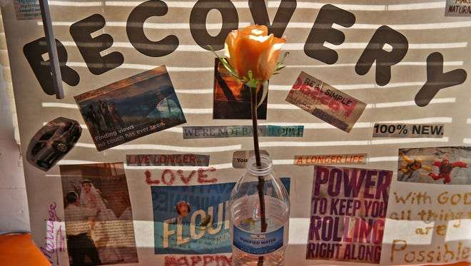 A resident at Dove Recovery House for Women keeps inspirational items in her room. The half-way house provides transitional housing for women recovering from substance abuse.