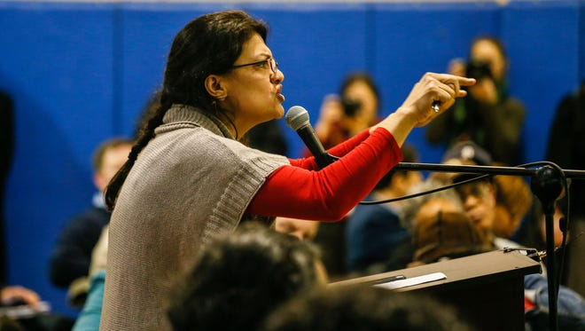 Former State Rep. Rashida Tlaib addresses the Detroit City Council during the Detroit City Council Committee of the Whole-Public hearing for the Marathon Petroleum Company proposal at Patton Park community center in southwest Detroit on Thursday, Jan. 28, 2016.
