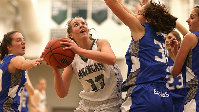 Fossil Ridge's Britt Mishak puts up a shot during the Sabercats' 40-39 loss to the Broomfield Eagles on Friday, Jan. 29, 2016, in Fort Collins, Colo. Mishak led the Sabercats with 12 points.