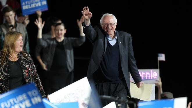 Democratic presidential candidate Bernie Sanders greets attendees at the University of Iowa Field House on Saturday, Jan. 30, 2016.