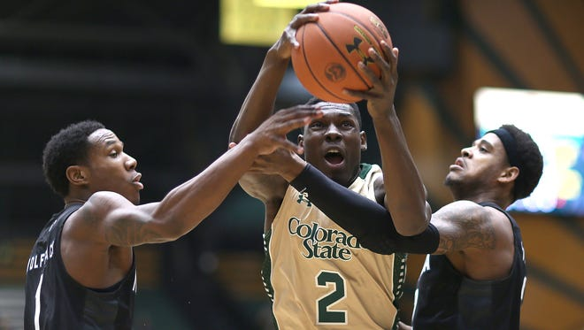 Rams' forward Emmanuel Omogbo attempts to secure an offensive rebound during CSU's game against the Nevada Wolf Pack on Saturday, Feb. 6, 2016, at Moby Arena in Fort Collins.