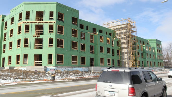 Construction continues at an apartment complex on Riverside Drive on Tuesday, Feb. 9, 2016.