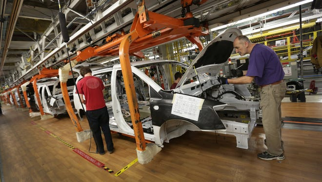 The Dodge Grand Caravan is being built at the Fiat Chrysler Automobiles assembly plant in Windsor, Ontario, on Monday, February 9, 2015.