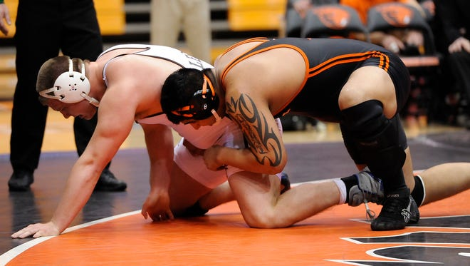 Oregon State heavyweight Amarveer Dhesi (right) is 23-3 on the season and has won nine consecutive matches.