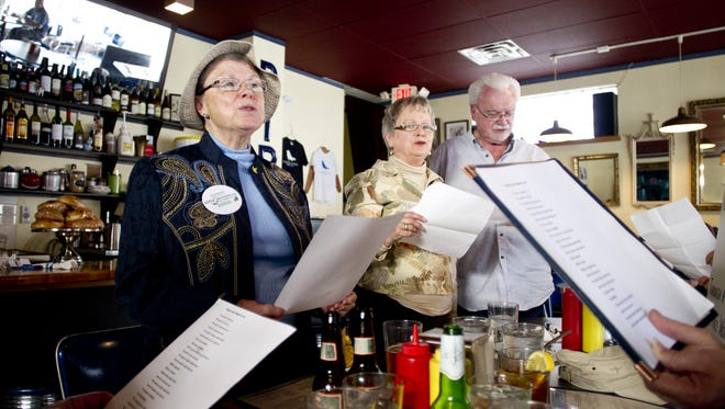In this 2014 file photo, Barbara Schlachter, left, sings for her supper at the Bluebird Diner in Iowa City.   Benjamin Roberts / Iowa City Press-Citizen Barbara Schlachter, left, Maureen Arensdorf, middle, and husband Nick sing for their supper at the Bluebird Diner in Iowa City, IA on Sunday, April 6, 2014. Benjamin Roberts / Iowa City Press-Citizen