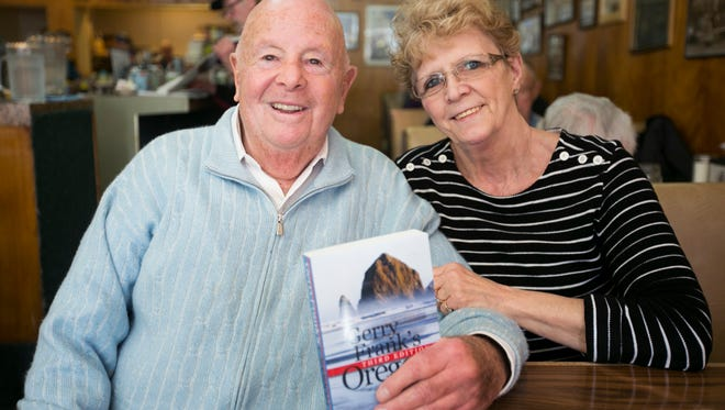 """Gerry Frank came to Holding Court to talk about the third edition of his new book, """"Gerry Frank's Oregon."""" Here he shows off a copy with Marlene Blanchard, owner of the Court Street Dairy Lunch. The two have been friends for almost three decades."""
