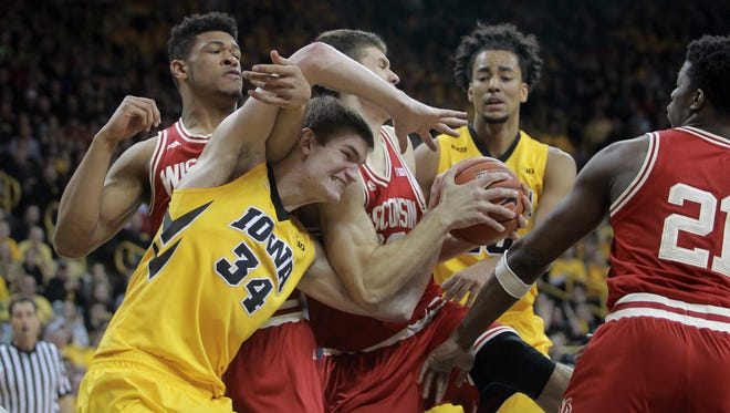 Iowa's Adam Woodbury fights for a rebound during the Hawkeyes' game against Wisconsin at Carver-Hawkeye Arena on Wednesday, Feb. 24, 2016.