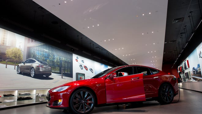 The Tesla Model S P90D sits at the Tesla Motors Showroom in Scottsdale Fashion Square, in Ariz. on Feb 26, 2016.