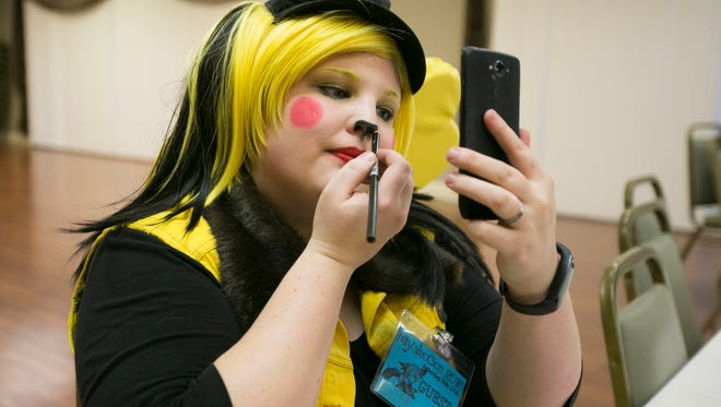 Sheri Budrow, dressed as Pikachu from Pokemon, fixes her makeup before hosting a panel event at MiyakoCon 2016 at the Red Lion Hotel on Saturday, Feb. 27, 2016. Budrow spoke about how to Cosplay villains without actually being a bad guy.