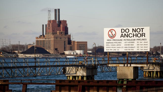 A sign warns boaters of pipelines under the St. Clair River on Friday, Jan. 2, 2015 in Corunna, Ontario.