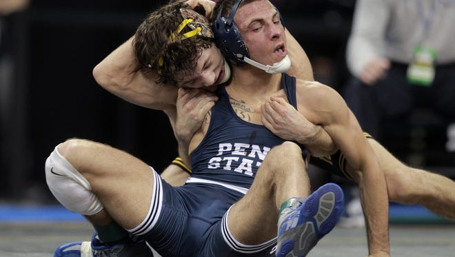 Iowa's Thomas Gilman wrestles Penn State's Nico Megaludis in the 125 pound semifinals at the Big Ten Championships at Carver-Hawkeye Arena on Saturday, March 5, 2016.