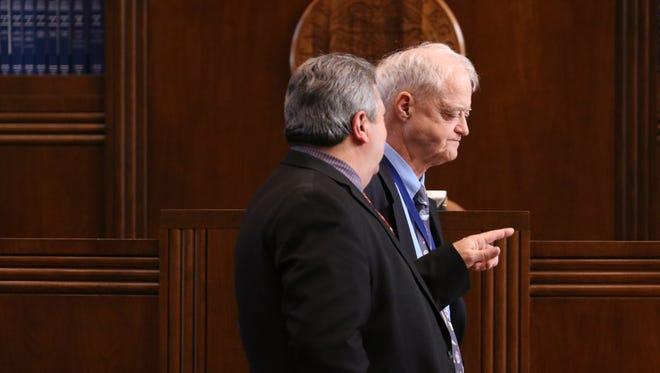 Senate President Peter Courtney, right, speaks with Republican Senate Leader Ted Ferrioli as the Legislature wraps on Thursday.