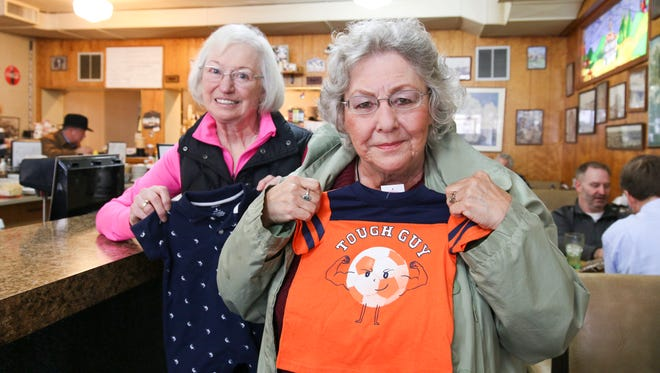 Mary Cooper, left, and her sister-in-law Roxie Cooper, both members of the Rotary Club of Salem Sunset, show off new baby items that will become part of the 11th Annual Community Baby Shower on April 30. The club is offering a drive-through drop-off service at Salem's Riverfront Park this year for busy community members who want to donate a new or handmade item to help needy new parents.