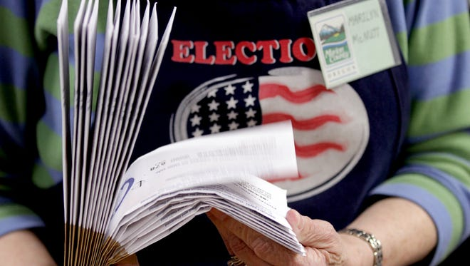 A woman verifies ballot precincts at the Marion County Election Office in 2015.