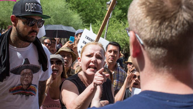 Protesters exchange words outside a July rally for Republican presidential candidate Donald Trump. His controversial and sometimes offensive remarks on immigration, Mexicans and Muslims have prompted protests.