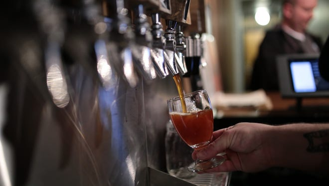 People order beer at Batch Brewing Company during the Detroit Free Press first Detroit Untapped brewery bus tour on Thursday, March 24, 2016, in Detroit.