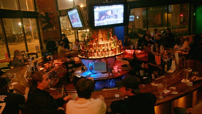 People enjoy the Tiger's baseball game at Park Bar, across from Comerica Park in Detroit Friday April 27, 2007.