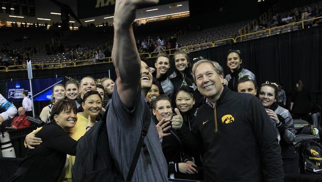 University of Iowa President Bruce Harreld takes a selfie Iowa gymnasts at the NCAA Gymnastics Regionals at Carver-Hawkeye Arena on Saturday, April 2, 2016.