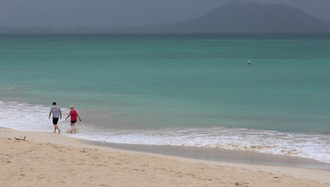 Kailua Beach, one of the most beautiful in the United States, is nearly empty during a morning rainstorm in Oahu, Hawaii. This is where President Obama vacations.