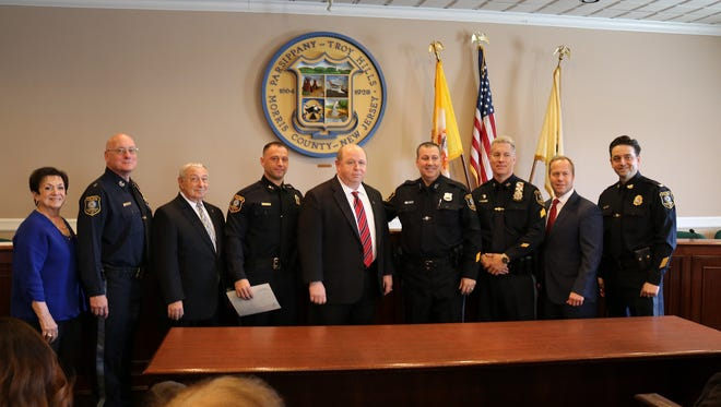 Parsippany police promotion ceremony April 6: from left, ) Council Member Loretta Gragnani, Chief of Police Paul Philipps, Councilman Michael J. dePierro, Sgt. Daniel Conte, Mayor James Barberio, Sgt. Michael Kimble, Lt. Thomas Pomroy, Council President Louis Valori, Deputy Chief Richard Pantina.