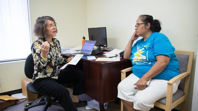 Laura Castillo, right, learns about treatment of her hepatitus C infection from Dr. Katie Moizeau Thursday, March 3, 2016, during a weekly clinic in Sacramento.