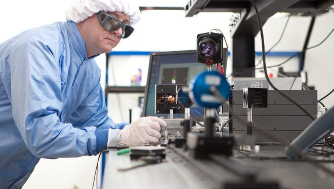 A LaserMax employee works on a product for the company.