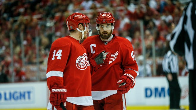 Red Wings forwards Gustav Nyquist and Henrik Zetterberg talk before a power play during the third period of the Wings' 2-0 win over the Lightning in Game 3 of the Eastern Conference quarterfinals Sunday at Joe Louis Arena.