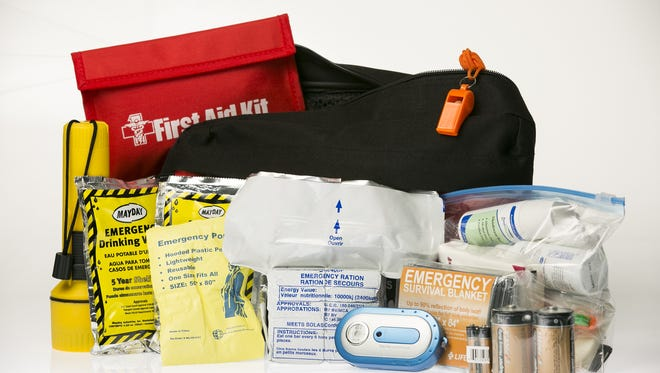 American Red Cross one person disaster kit for car or office use. The kit includes a flashlight, first aid kit, drinking water, poncho, emergency rations, FM/AM radio, survival blanket, batteries and personal hygiene and first aid products.