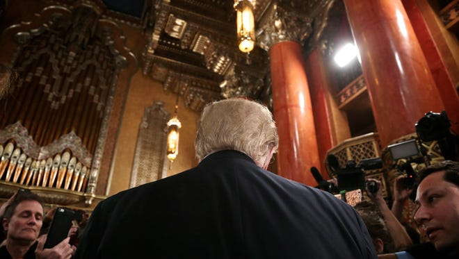 Republican presidential candidates Donald Trump talks to the media after the Fox News GOP debate in March at the Fox Theater in Detroit.