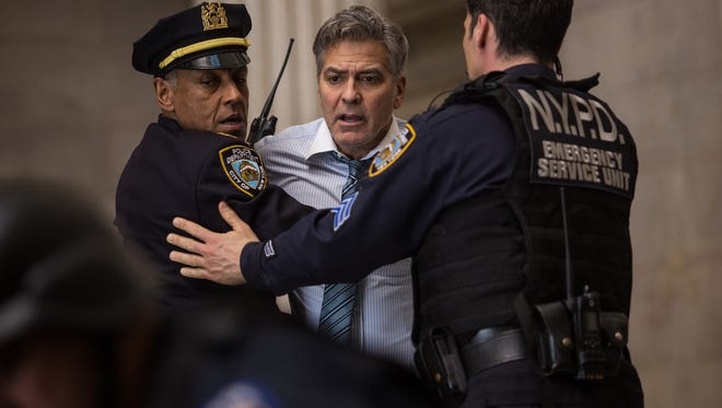 "George Clooney, center,   with Giancarlo Esposito, left, in ""Money Monster."""