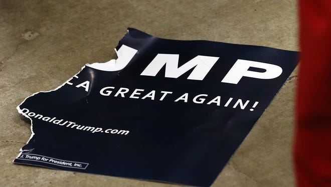 A sign that was torn in half by a protestor during a rally for Donald Trump at the Indiana State Fairgrounds, Indianapolis, Wednesday, April 20, 2016.