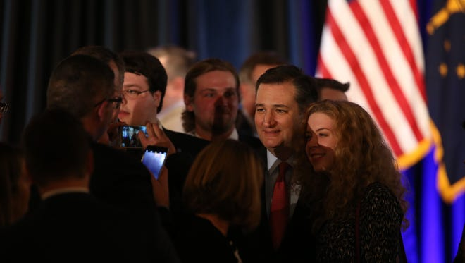 Sen. Ted Cruz poses for a picture with Indiana University student Katherine Hitchcock during the Indiana Republican Party spring dinner at Primo's Banquet Center, Indianapolis, Thursday, April 21, 2016.