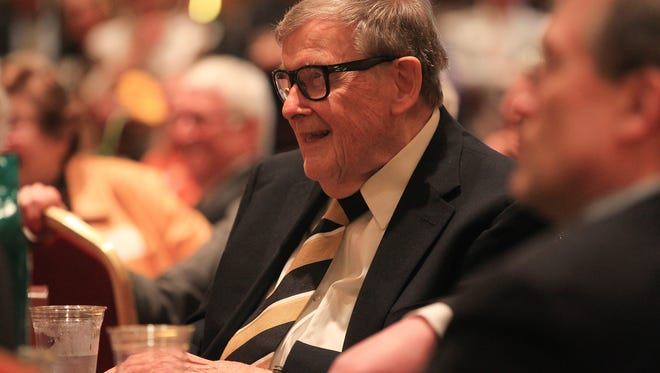 "Former University of Iowa President Willard ""Sandy"" Boyd laughs as friends tell stories during a reception for him at the Coralville Marriott on Thursday, April 28, 2016."