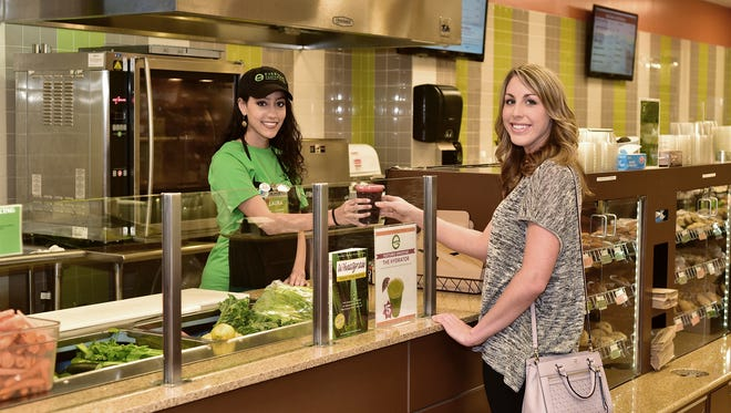 Ever'man juice bar patron Joanna Holt orders a Body Cleanser, a power-packed blend of carrot, beet and cucumber juices.