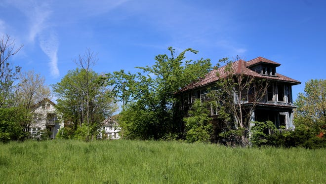 Abandoned homes near the corner of Moore and Whitewood in Detroit near the I-94 and -96 freeways on Wednesday, May 20, 2015.Detroit Mayor Mike Duggan has worked at getting the city's blight problem under control and introduced a vacant lot lease for residences that should be available by this summer.