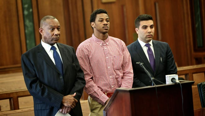 Former MSU star Keith Appling, center, along his attorneys Cyril C. Hall, left, and Amir I. Makled, during an arraignment on Wednesday, May 4, 2016, at the 19th District Court in Dearborn.