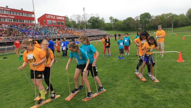 Students compete in the buddy race during Kids Track at City High on Tuesday, May 10, 2016.