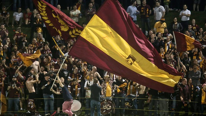 Detroit City FC fans cheer for their team during DCFC's 1-0 win over the Michigan Bucks on penalty kicks in the first round of the U.S. Open Cup tournament Wednesday at Oakland University.