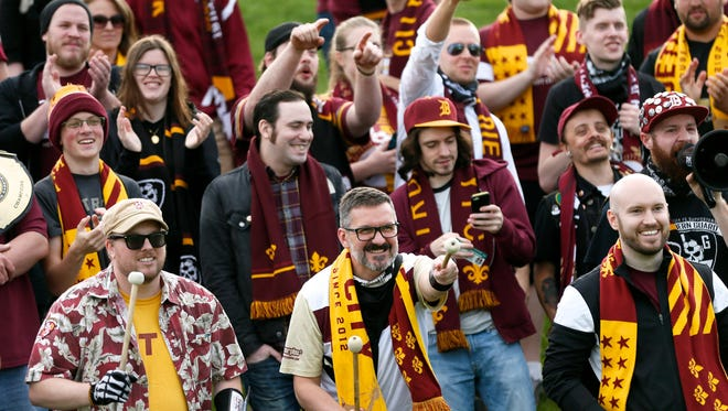 Detroit City FC fans cheer for their team during DCFC's 1-0 win on penalty kicks over the Michigan Bucks in the first round of the U.S. Open Cup Wednesday at Oakland University.