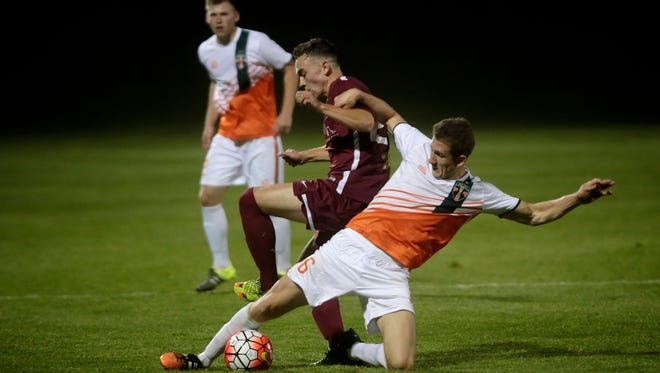 Michigan Bucks midfielder Tom Owens steals the ball from Detroit City FC Danny Deakin on Wednesday, May 11, 2016, at Oakland University in Auburn Hills, MI, during the U.S. Open Cup.