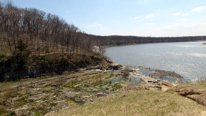 The Iowa River flows through Lake Macbride State Park on Friday, April 15, 2016.