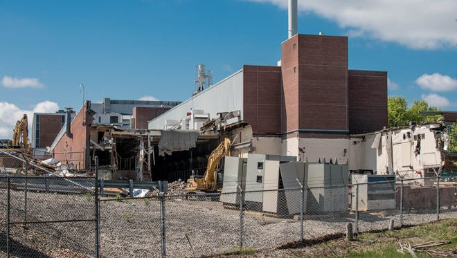 Demolition has begun at a Kellogg Co. office building on Porter Street in Battle Creek. The project is expected to be completed later this year.