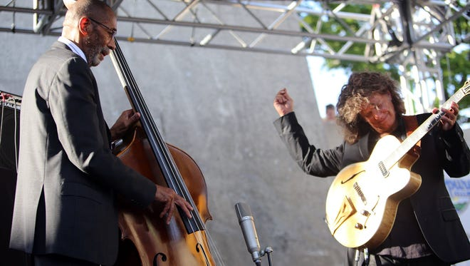 The 2015 Detroit Jazz Festival included a rare duet performance by legendary Detroit bassist Ron Carter and guitarist Pat Metheny. bring their first  song to a close during the top of their performance at the 36th Annual Detroit Jazz Festival on Sunday, Sept. 6, 2015 on the Wayne State University Pyramid Stage in Hart Plaza. The festival is the largest free-of-charge jazz fest in the world.