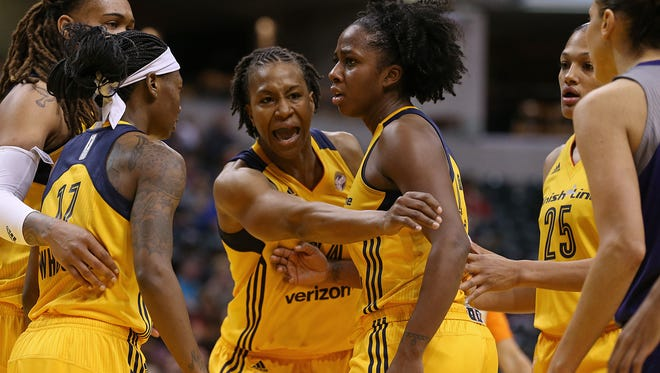 Indiana Fever forward Tamika Catchings (24) intervenes on a scuffle in the second quarter after a verbal exchange between Indiana Fever guard Shenise Johnson (42) and Phoenix Mercury guard Diana Taurasi (3), which led to a double technical, during an Indiana Fever game against Phoenix Mercury, Banker's Life Fieldhouse, Indianapolis, Wednesday, May 18, 2016.