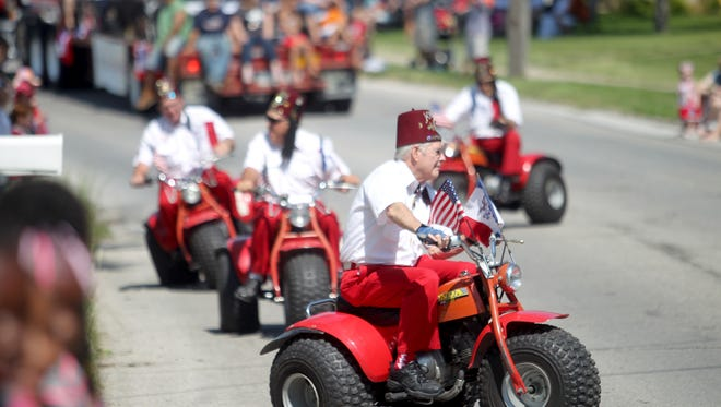 Shriners participate in the annual 4th Fest parade in Coralville on Thursday, July 4, 2013.
