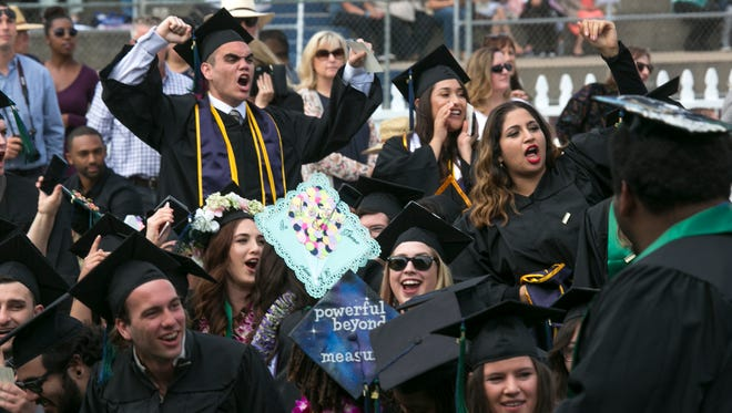Graduates celebrate during Saturday's 20th commencement at CSU Monterey Bay.
