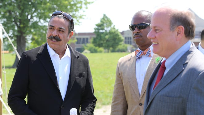 Shahid Khan, owner of Flex-N-Gate,  City of Detroit councilman for District 3, Scott Benson and Detroit Mayor, Mike Duggan,  before a press conference at a 30 acre site at the I-94 Industrial park area near the Detroit City airport on where Khan is proposing to build a facility to supply Ford vehicles and create up to 650 jobs on Wednesday, May 25, 2016.